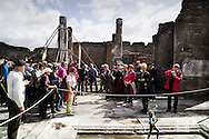 Pompei, Italia - 21 aprile 2012. Turisti visitano la domus del Fauno all'interno degli scavi archeologici di Pompei. Sullo sfondo una delle tante colonne puntellate in quanto pericolante.<br /> Ph. Roberto Salomone Ag. Controluce<br /> ITALY - Turist visit the house of the Faun inside the archeological site of Pompeii on April 21, 2012. In the background one of the many colums that need support in order to not fall apart.