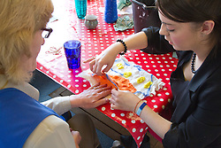 Felt making class for people with a visual impairment - feeling pocket in felted wool design with volunteer helper.