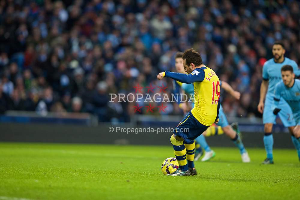 MANCHESTER, ENGLAND - Sunday, January 18, 2015: Arsenal's Santi Cazorla scores the first goal against Manchester City from the penalty spot during the Premier League match at the City of Manchester Stadium. (Pic by David Rawcliffe/Propaganda)