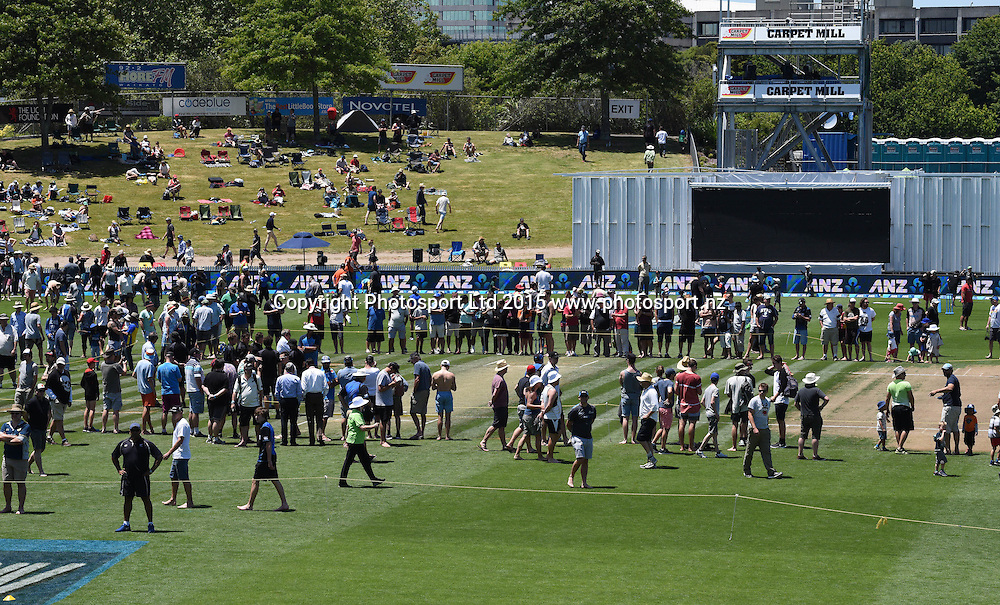 Fans on the wicket during the lunch break on day 2 of the 2nd cricket test match between New Zealand Black Caps and Sri Lanka at Seddon Park in Hamilton, New Zealand. Saturday 19 December 2015. Copyright photo: Andrew Cornaga / www.photosport.nz