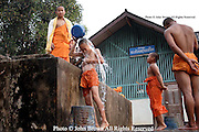 A group of novice Buddhist monks tend to a daily ritual of maintaining their personal health and hygiene at a temple located near the Mekong RIver in Huay Xai, Thailand.