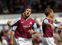 Photo: Chris Ratcliffe.<br /> West Ham United v Tottenham Hotspur. The Barclays Premiership. 07/05/2006.<br /> Carl Fletcher celebrates scoring West Ham's opener.