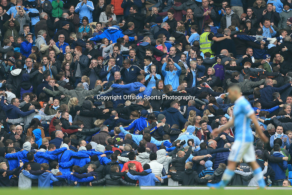 3rd October 2015 - Barclays Premier League - Manchester City v Newcastle United - Man City fans celebrate by performing their 'Poznan' dance as Sergio Aguero of Man City walks off after being substituted, having scored 5 goals - Photo: Simon Stacpoole / Offside.