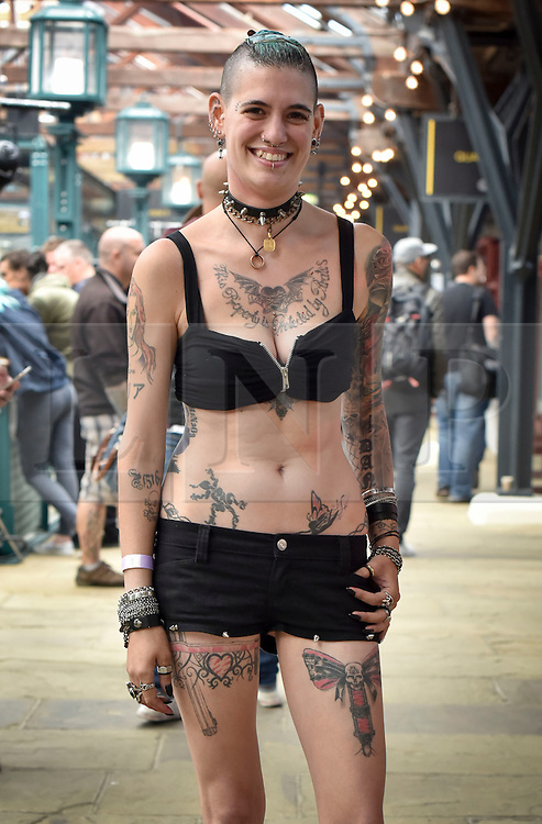 © licensed to London News Pictures. 25/09/2015<br /> The 11th London International Tattoo Convention, one of the most prestigious body art conventions in the world, brought together 400 of the best tattoo artists to thousands of admirers at Tobacco Dock. Other attractions and alternative performances included burlesque, sword swallowing, striptease dancers, fire-dancers and trapeze performers. Pictured Tattoo fan Sylvia from Italy.<br /> Photo credit : Ian Whittaker/LNP