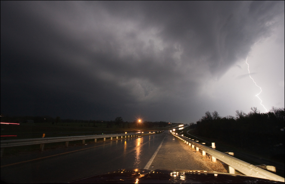 Tornado warned supercell with cloud to ground lightning crossing Interstate 49 near Butler, Missouri.
