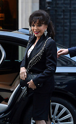 Joan Collins arrives at 10 Downing Street, London, UK, for a reception to celebrate inspirational women.<br />  Thursday, 6th March 2014. Picture by Ben Stevens / i-Images