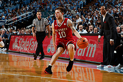 CHAPEL HILL, NC - JANUARY 27: Braxton Beverly #10 of the North Carolina State Wolfpack dribbles the ball against the North Carolina Tar Heels on January 27, 2018 at the Dean Smith Center in Chapel Hill, North Carolina. North Carolina lost 95-91. (Photo by Peyton Williams/UNC/Getty Images) *** Local Caption *** Braxton Beverly