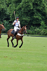NINA CLARKIN playing polo (white shirt no 4.) at a charity polo match organised by Jaeger Le Coultre was held at Ham Polo Club, Richmond, Surrey on 12th June 2009.