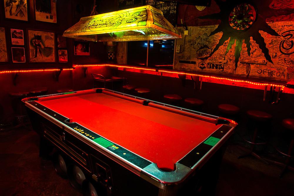 Where: Kuala Lumpur, Malaysia. <br /> Red pool table in a bar.
