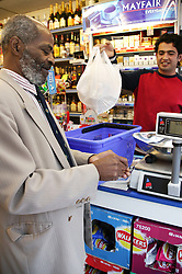 Man being served at his local shop; East Midlands Supermarket; Nottingham,