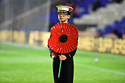 A young Cadet holds a poppy during the EFL Sky Bet Championship match between Birmingham City and Brentford at St Andrews, Birmingham, England on 1 November 2017. Photo by Dennis Goodwin.