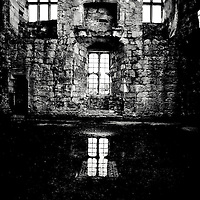 Interior of Tudor House, windows, fireplace, old stone with water soaked floor reflecting windows