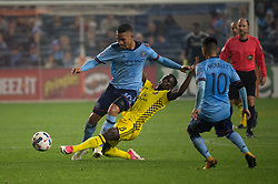 November 5, 2017 - Bronx, New York, U.S - Columbus Crew midfielder MOHAMMED ABU (8) slides in to knock the ball away New York City FC midfielder YANGEL HERRERA (30) while New York City FC midfielder MAXIMILIANO MORALEZ (10) looks on from during leg 2 of the Eastern Conference Semifinal at Yankee Stadium, Bronx, NY.  NYCFC defeats Columbus Crew 2-0.  Columbus wins 4-3 on aggregate. (Credit Image: © Mark Smith via ZUMA Wire)