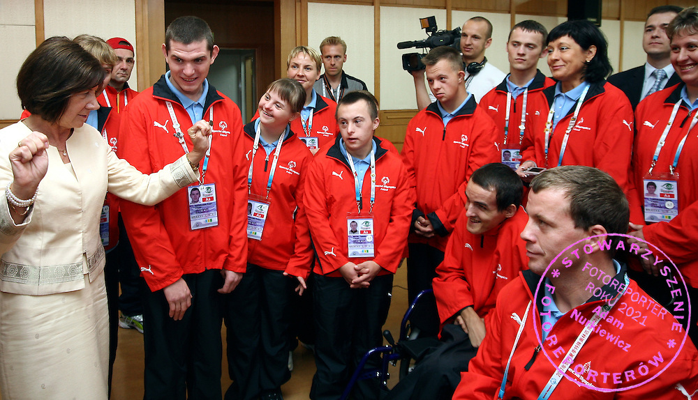 POLISH FIRST LADY MARIA KACZYNSKA WITH SPECIAL OLYMPICS ATHLETES FROM POLAND DURING OFFICIAL VISIT AT JINWAN HOTEL AT THE SPECIAL OLYMPICS WORLD SUMMER GAMES SHANGHAI 2007..SPECIAL OLYMPICS IS AN INTERNATIONAL ORGANIZATION DEDICATED TO EMPOWERING INDIVIDUALS WITH INTELLECTUAL DISABILITIES..SHANGHAI , CHINA , OCTOBER 03, 2007.( PHOTO BY ADAM NURKIEWICZ / MEDIASPORT )..