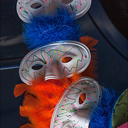Display of face masks outdoors. <br /> <br /> Mask: to disguise, conceal, cloak, hide or screen.