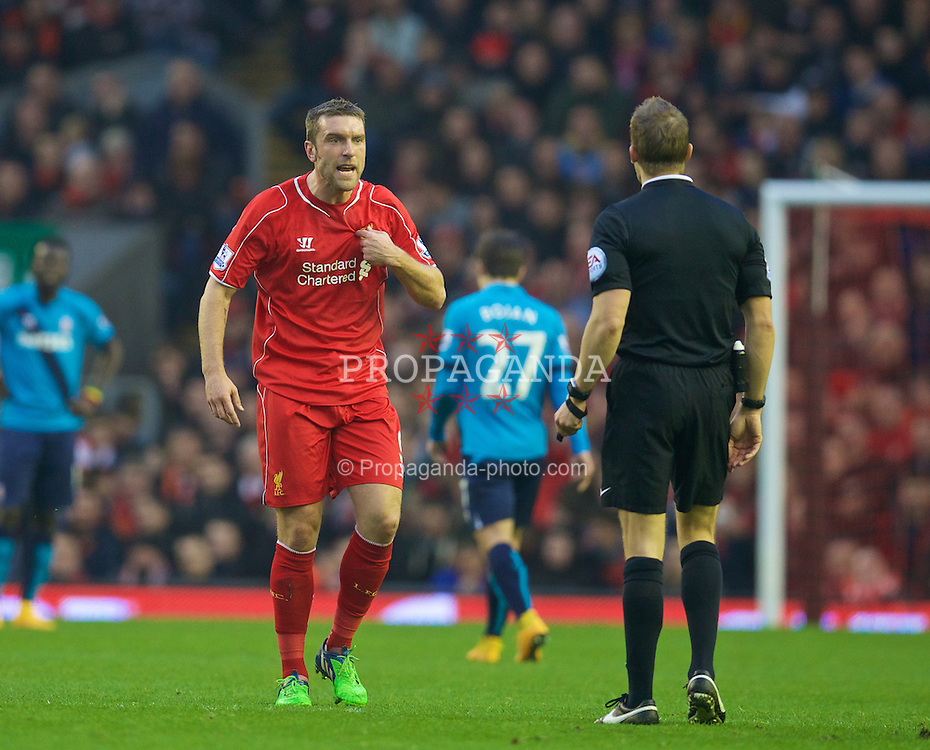 LIVERPOOL, ENGLAND - Saturday, November 29, 2014: Liverpool's Rickie Lambert argues with referee Craig Pawson during the Premier League match against Stoke City at Anfield. (Pic by David Rawcliffe/Propaganda)