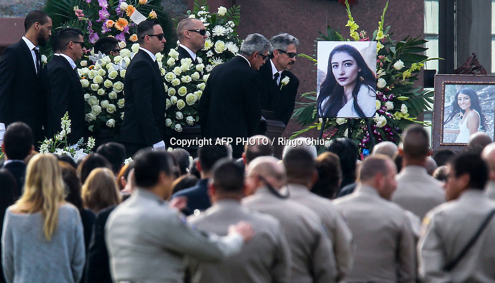"Pallbearers carry the casket of Yvette Velasco as they arrive at a memorial service at the Forest Lawn in Covina on Thursday, December 10, 2015. Velasco is one of the youngest victims killed in the December 2 mass shooting in San Bernardino. Velasco was at the training and holiday luncheon at the Inland Regional Center when Syed Farook and his wife, Tashfeen Malik, barged in on the gathering and opened fire on his San Bernardino County Department of Public Health coworkers.The husband and wife sprayed the conference room with gunfire, killing 14 and injuring 21 others in what the FBI is investigating as an ""act of terrorism."""