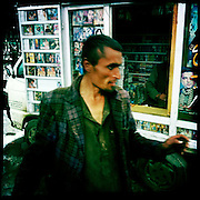 A man dances next to a mobile stall selling bootleg tapes.