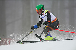Hiraku MISAWA competing in the Alpine Skiing Super Combined Slalom at the 2014 Sochi Winter Paralympic Games, Russia