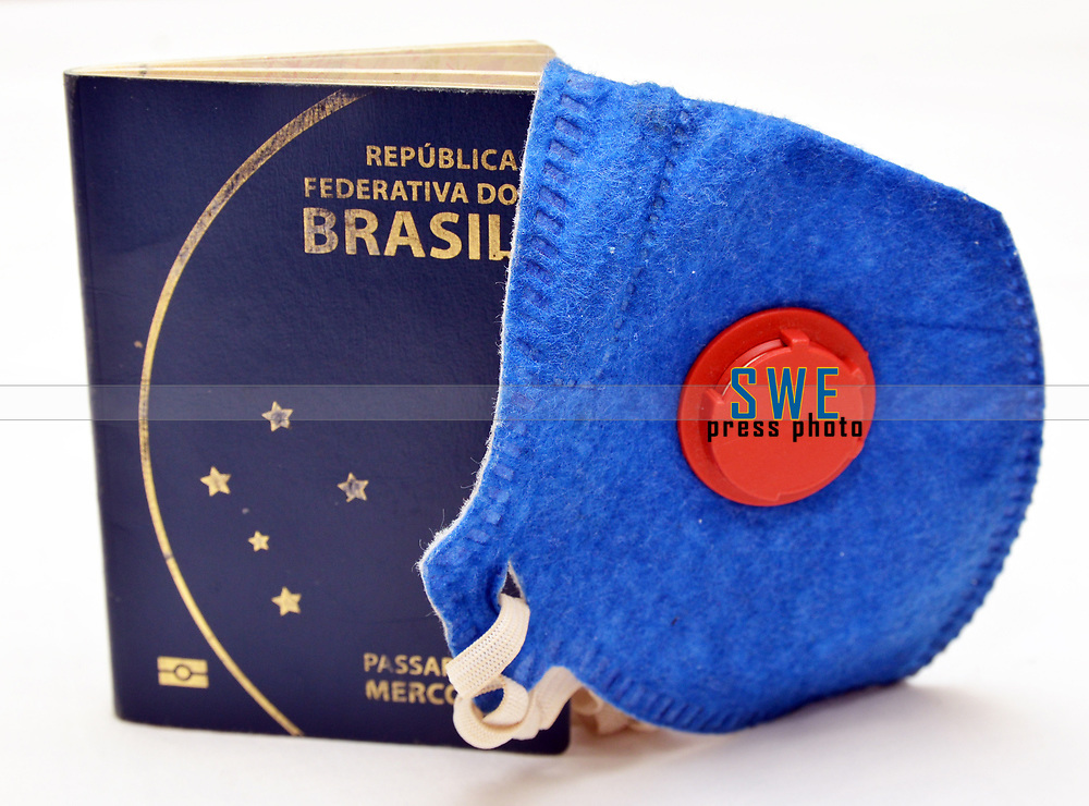 Brazil passport and mask, for protection from the coronavirus (covid19)