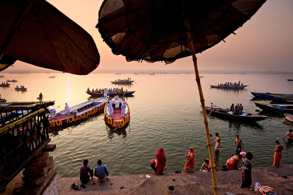 Reverential bathing in the Ganges River at sunrise, Varanasi, India.