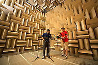 Partners and a student work in the anechoic chamber on Centennial Campus. Photo by Marc Hall