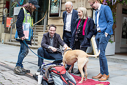"© Licensed to London News Pictures. 20/06/2019. Manchester, UK. In one of his last actions as Liberal Democrat Party leader , SIR VINCE CABLE arrives to meet Big Issue seller JUSTIN GREEN (49) and his dog BUMPER (ten), in Manchester City Centre , alongside Cllr JOHN LEACH and JANE BROPHY MEP . The party say they are highlighting what they call a "" Homeless Tax "" , which they oppose , and which could see fines of up to £1,000 imposed upon the homeless by Manchester City Council . The final Local Government Information Unit (LGiU) report from the Local Government Homelessness Commission (LGHC) – a year-long initiative set up to investigate how councils can fulfil their obligation to prevent homelessness - is due to be published . The Liberal Democrats will appoint a new leader in July . Photo credit: Joel Goodman/LNP"
