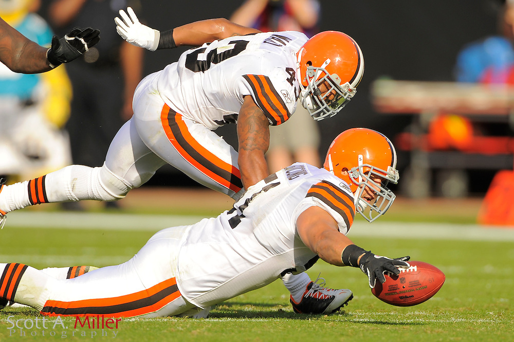 Cleveland Browns linebacker Chris Gocong (51) recovers a fumble during the Browns 24-20 loss to the Jacksonville Jaguars at EverBank Field on Nov. 21, 2010 in Jacksonville, Florida. ..©2010 Scott A. Miller
