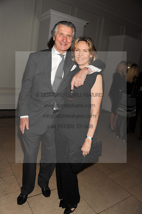 ARNAUD BAMBERGER Executive Chairman Cartier UK and CARLA BAMBERGER  at a reception to present the new Cartier Tank Watch Collection held at The Orangery, Kensington Palace Gardens, London W8 on 19th April 2012.