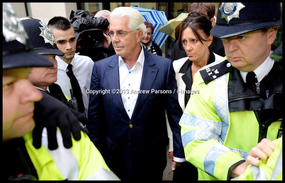 PR guru Max Clifford and his Partner Jo Westwood leave Westminster Magistrates' Court, London, charged with 11 indecent assaults allegedly committed between 1966 and 1985, .Tuesday, 28th May 2013.Picture by Andrew Parsons / i-Images
