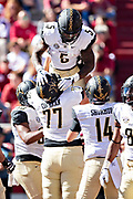 FAYETTEVILLE, AR - OCTOBER 27:  Ke'Shawn Vaughn #5 is lifted in the air by Devin Cochran #77 of the Vanderbilt Commodores after scoring a touchdown during a game against the Arkansas Razorbacks at Razorback Stadium on October 27, 2018 in Fayetteville, Arkansas. The Commodores defeated the Razorbacks 45-31.  (Photo by Wesley Hitt/Getty Images) *** Local Caption *** Ke'Shawn Vaughn; Devin Cochran