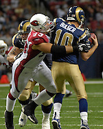 Arizona Cardinals defensive end Chris Cooper (93) sacks St. Louis Rams quarterback Marc Bulger in the fourth quarter, at the Edward Jones Dome in St. Louis, Missouri, December 3, 2006.  The Cardinals beat the Rams 34-20.<br />