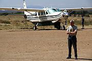 Tanzania wildlife safari European boarding a plane for sightseeing