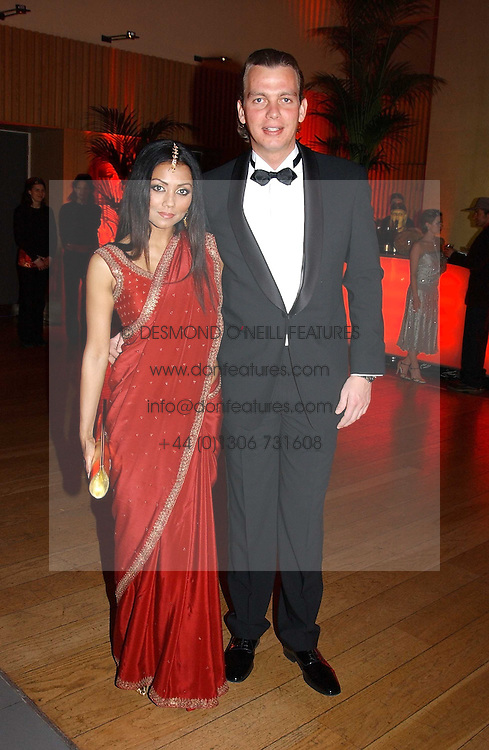 AKHEE RAHMAN and WERNER MUERZ at Andy &amp; Patti Wong's Chinese New Year party to celebrate the year of the Rooster held at the Great Eastern Hotel, Liverpool Street, London on 29th January 2005.  Guests were invited to dress in 1920's Shanghai fashion.<br />