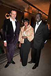 Left to right, TOM DIXON, SOFIA FOSTER and architect DAVID ADJAYE at a dinner to celebrate the opening of 'Maharaja - The Spendour of India's Royal Courts' an exhbition at the V&A, London on 6th October 2009.