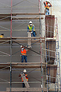 Construction workers working on a building downtown.