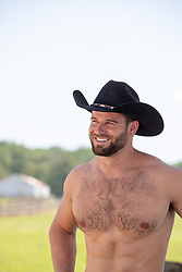 shirtless rugged cowboy outdoors