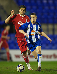 BIRKENHEAD, ENGLAND - Thursday, March 25, 2010: Liverpool's Jordy Brouwer and Wigan Athletic's captain Jon Routledge during the FA Premiership Reserves League (Northern Division) match at Prenton Park. (Photo by David Rawcliffe/Propaganda)
