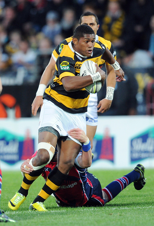 Taranaki's Waisake Naholo makes a break against the Tasman Makos in the ITM Cup Rugby Premiership final match at Yarrow Stadium, New Plymouth, New Zealand, Saturday, October 25, 2014. Credit:SNPA / Ross Setford