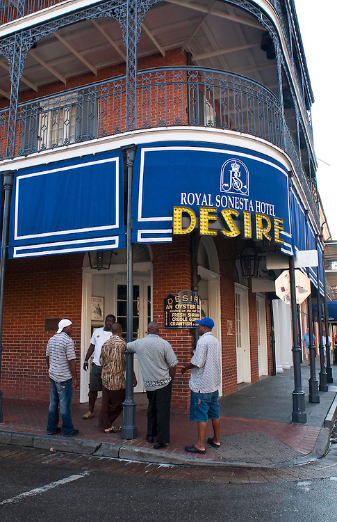 A group of African American men gather outside The Desire Oyster Bar on the corner of Bourbon and Bienville Street in the French Quarter in New Orleans, LA.