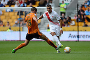 Ahmed Kashi plays the ball past Conor Coady during the Sky Bet Championship match between Wolverhampton Wanderers and Charlton Athletic at Molineux, Wolverhampton, England on 29 August 2015. Photo by Alan Franklin.