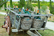 Wine flagons on old farm cart near Montalcino, Val D'Orcia, Tuscany, Italy RESERVED USE - NOT FOR DOWNLOAD - FOR USE CONTACT TIM GRAHAM