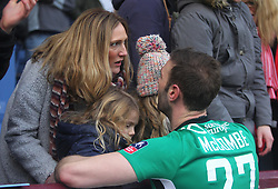 Jamie McCombe of Lincoln City celebrates with his family after beating Burnley - Mandatory by-line: Jack Phillips/JMP - 18/02/2017 - FOOTBALL - Turf Moor - Burnley, England - Burnley v Lincoln City - FA Cup Fifth Round