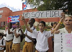 December 3, 2016 - Santiago De Cuba, CUB - Cubans wait for the passage of Fidel Castro's ashes outside a clinic on the route to the Moncada Barracks, in Santiago de Cuba on Saturday, Dec. 3, 2016. (Credit Image: © Al Diaz/TNS via ZUMA Wire)