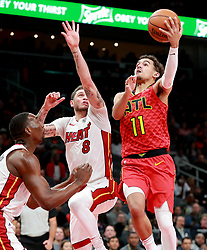 January 6, 2019 - Atlanta, GA, USA - Atlanta Hawks guard Trae Young goes to the basket for two points over Miami Heat guard Tyler Johnson during the first half on Sunday, Jan. 6, 2019 at State Farm Arena in Atlanta, Ga. The Hawks beat the Heat, 106-82. (Credit Image: © Curtis Compton/Atlanta Journal-Constitution/TNS via ZUMA Wire)