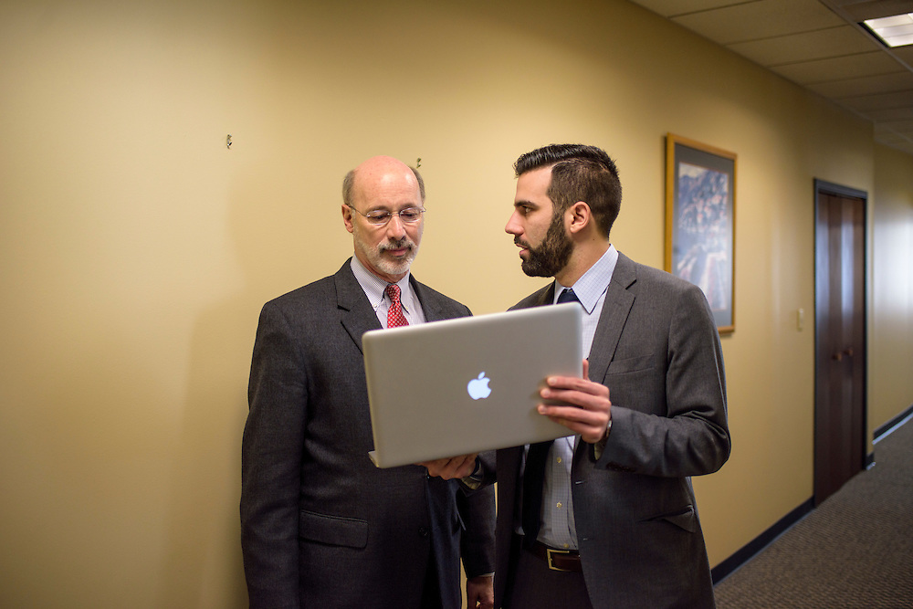 Harrisburg, Pennsylvania - January 15, 2015: Tom Wolf, the new Democratic Pennsylvania governor, has a quick hallway meeting with special assistant to governor Rob Ghormoz in his new office at Strawberry Square in Harrisburg, PA Thursday January 15, 2015.<br /> <br /> CREDIT: Matt Roth for The New York Times<br /> Assignment ID: 30169436A
