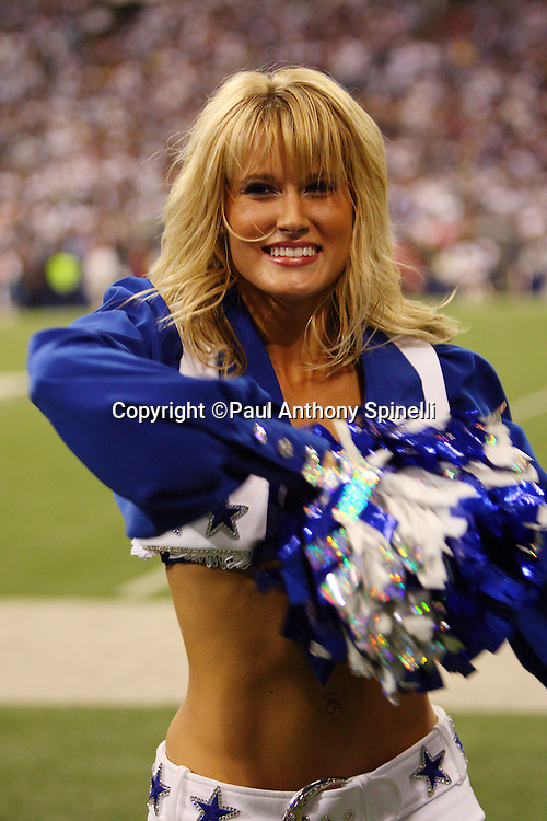 IRVING, TX - SEPTEMBER 15:  A Dallas Cowboys cheerleader cheers during a dance routine at the game against the Philadelphia Eagles at Texas Stadium on September 15, 2008 in Irving, Texas. The Cowboys defeated the Eagles 41-37. ©Paul Anthony Spinelli