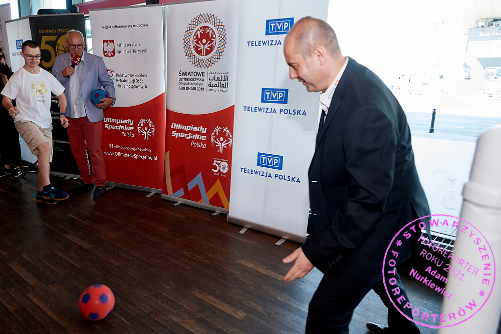 Warsaw, Poland - 2018 May 10: (L) Special Olympics Athete Kuba Kazibet shoots on goal and (R) Dariusz Wosz saves while Special Olympics Press Conference at Marriott Champions Sport Bar on May 10, 2018 in Warsaw, Poland.<br /> <br /> Adam Nurkiewicz declares that he has no rights to the image of people at the photographs of his authorship.<br /> <br /> Picture also available in RAW (NEF) or TIFF format on special request.<br /> <br /> Any editorial, commercial or promotional use requires written permission from the author of image.<br /> <br /> Image can be used in the press when the method of use and the signature does not hurt people on the picture.<br /> <br /> Mandatory credit:<br /> Photo by &copy; Adam Nurkiewicz / Mediasport