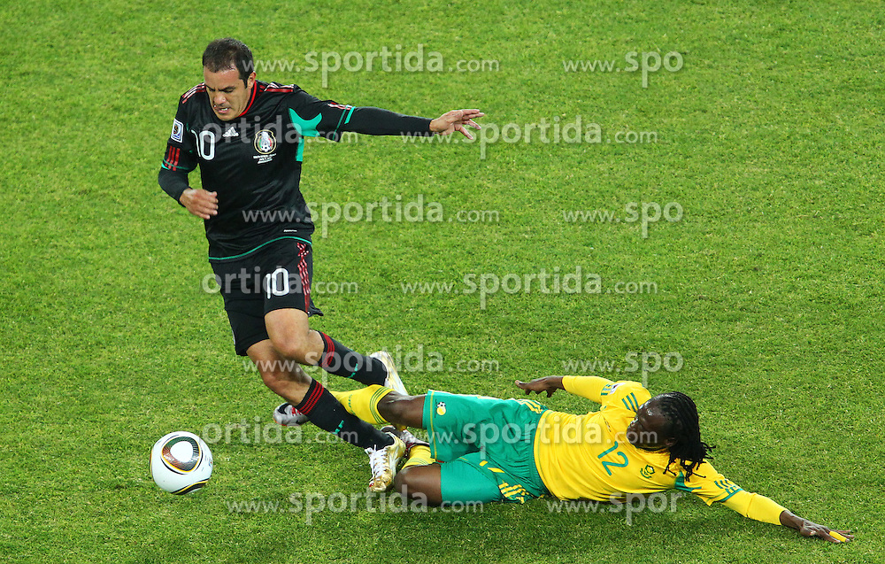 South Africa's Reneilwe Letsholonyane (R)  vs Mexico's Cuauhtemoc Blanco during the Group A first round 2010 FIFA World Cup South Africa match between South Africa and Mexico at Soccer City Stadium on June 11, 2010 in Johannesburg, South Africa.  (Photo by Vid Ponikvar / Sportida)