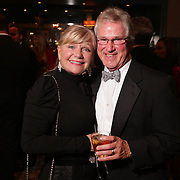 Sherri Drogue, left, and Marshall Gurley pose for a picture Saturday December 6, 2014 during the 9th Annual Wilmington Fur Ball at the Country Club of Landfall in Wilmington, N.C. (Jason A. Frizzelle)